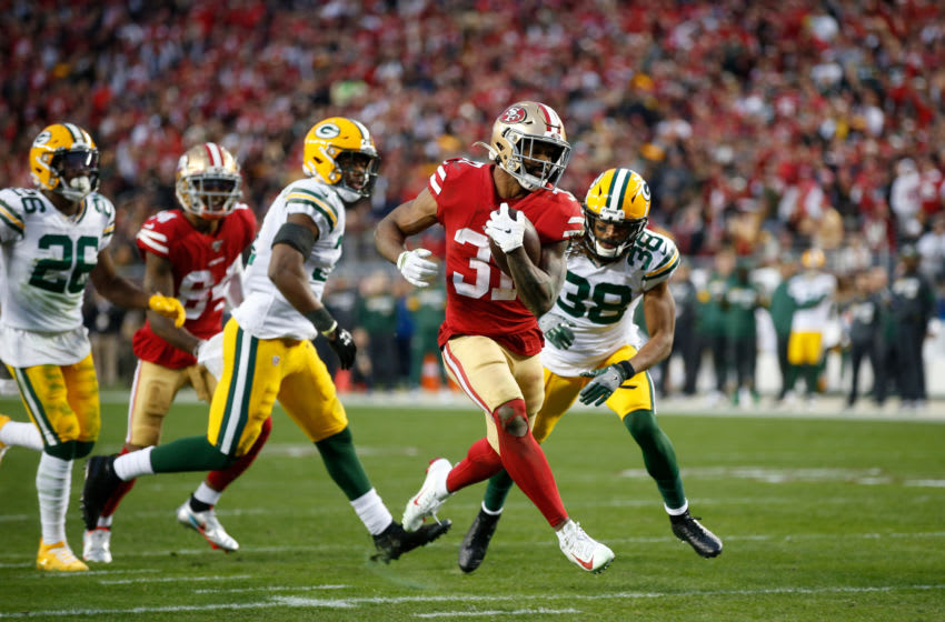 SANTA CLARA, CA - JANUARY 19: Raheem Mostert #31 of the San Francisco 49ers rushes for an 11-yard touchdown during the game against the Green Bay Packers at Levi's Stadium on January 19, 2020 in Santa Clara, California. The 49ers defeated the Packers 37-20. (Photo by Michael Zagaris/San Francisco 49ers/Getty Images)