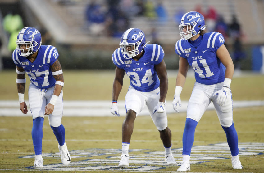 DURHAM, NC - NOVEMBER 30: Damani Neal #27, Sayyid Stevens #34 and Xander Gagnon #41 of the Duke Blue Devils line up during a game against the Miami Hurricanes at Wallace Wade Stadium on November 30, 2019 in Durham, North Carolina. Duke defeated Miami 27-17. (Photo by Joe Robbins/Getty Images)
