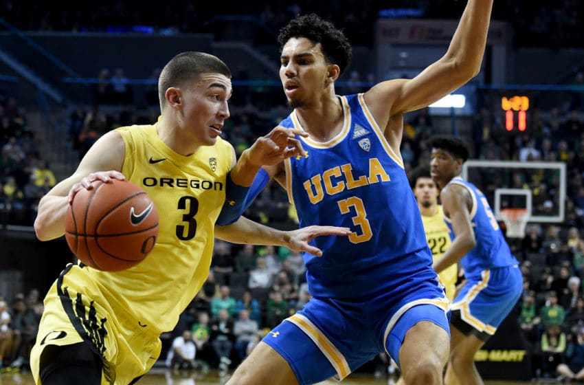 EUGENE, OREGON - JANUARY 26: Payton Pritchard #3 of the Oregon Ducks drives to the basket on Jules Bernard #3 of the UCLA Bruins during the first half at Matthew Knight Arena on January 26, 2020 in Eugene, Oregon. (Photo by Steve Dykes/Getty Images)