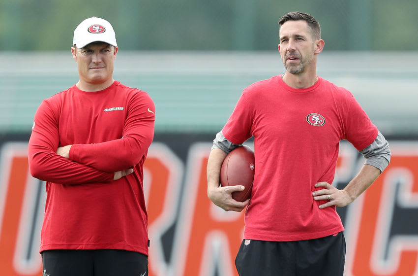 CORAL GABLES, FLORIDA - JANUARY 29: Head coach Kyle Shanahan of the San Francisco 49ers (R) talks with general manager John Lynch during practice for Super Bowl LIV at the Greentree Practice Fields on the campus of the University of Miami on January 29, 2020 in Coral Gables, Florida. (Photo by Michael Reaves/Getty Images)