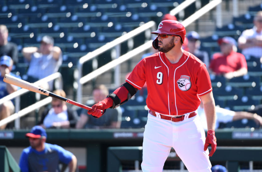 GOODYEAR, ARIZONA - FEBRUARY 24: Mike Moustakas #9 of the Cincinnati Reds gets ready in the batters box during a spring training game against the Texas Rangers at Goodyear Ballpark on February 24, 2020 in Goodyear, Arizona. (Photo by Norm Hall/Getty Images)