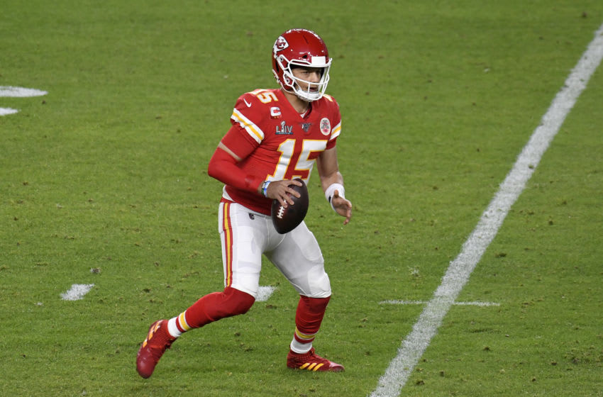 MIAMI, FLORIDA - FEBRUARY 02: Patrick Mahomes #15 of the Kansas City Chiefs looks to pass against the San Francisco 49ers in Super Bowl LIV at Hard Rock Stadium on February 02, 2020 in Miami, Florida. The Chiefs won the game 31-20. (Photo by Focus on Sport/Getty Images)