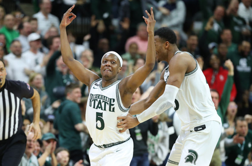 EAST LANSING, MICHIGAN - MARCH 08: Cassius Winston #5 of the Michigan State Spartans celebrates a second half three pointer with Xavier Tillman Sr. #23 while playing the Ohio State Buckeyes at the Breslin Center on March 08, 2020 in East Lansing, Michigan. Michigan State won the game 80-69. (Photo by Gregory Shamus/Getty Images)