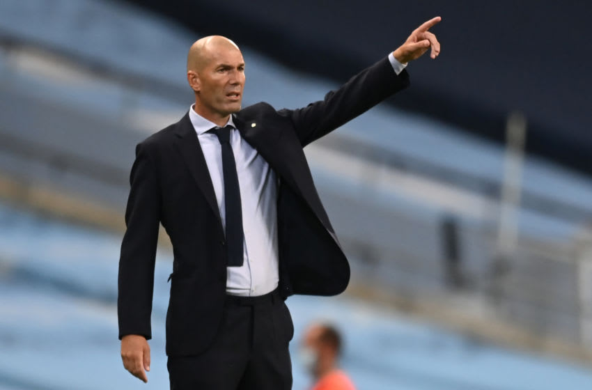 Real Madrid's French coach Zinedine Zidane shouts instructions to his players from the touchline during the UEFA Champions League round of 16 second leg football match between Manchester City and Real Madrid at the Etihad Stadium in Manchester, north west England on August 7, 2020. (Photo by Shaun Botterill / POOL / AFP) (Photo by SHAUN BOTTERILL/POOL/AFP via Getty Images)