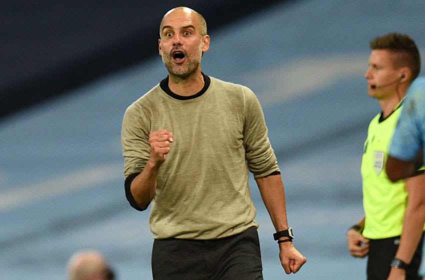 Manchester City's Spanish manager Pep Guardiola shouts instructions to his players from the touchline during the UEFA Champions League round of 16 second leg football match between Manchester City and Real Madrid at the Etihad Stadium in Manchester, north west England on August 7, 2020. (Photo by Oli SCARFF / POOL / AFP) (Photo by OLI SCARFF/POOL/AFP via Getty Images)
