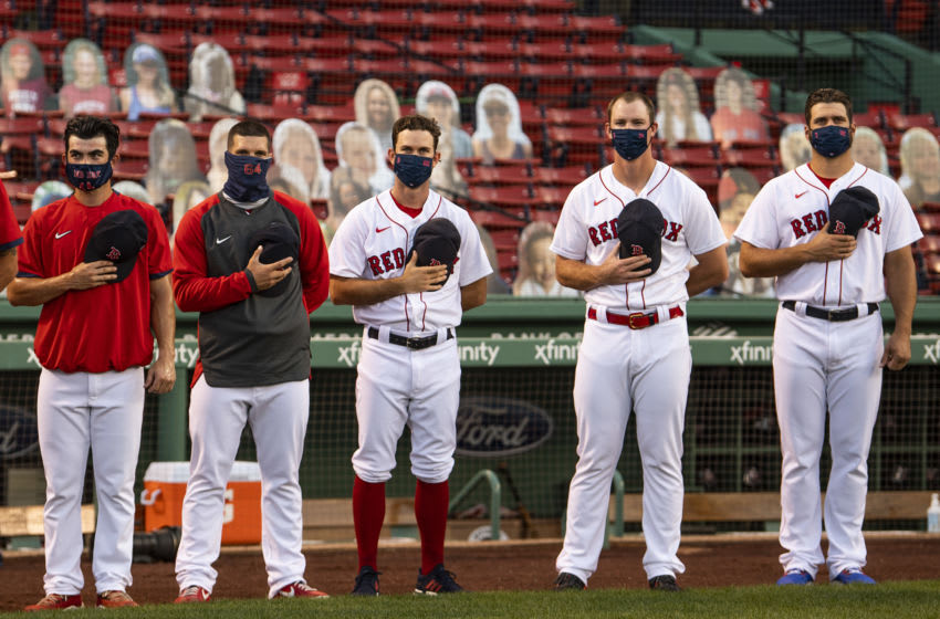 BOSTON, MA - AUGUST 12: Members of the Boston Red Sox wear masks as they look on before a game against the Tampa Bay Rays on August 12, 2020 at Fenway Park in Boston, Massachusetts. The 2020 season had been postponed since March due to the COVID-19 pandemic. (Photo by Billie Weiss/Boston Red Sox/Getty Images)