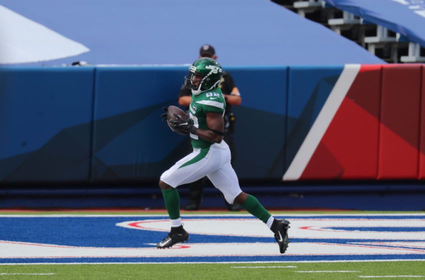 ORCHARD PARK, NY - SEPTEMBER 13: Jamison Crowder #82 of the New York Jets runs the ball in for a touchdown during the second half against the Buffalo Bills at Bills Stadium on September 13, 2020 in Orchard Park, New York. Bills beat the Jets 27 to 17. (Photo by Timothy T Ludwig/Getty Images)