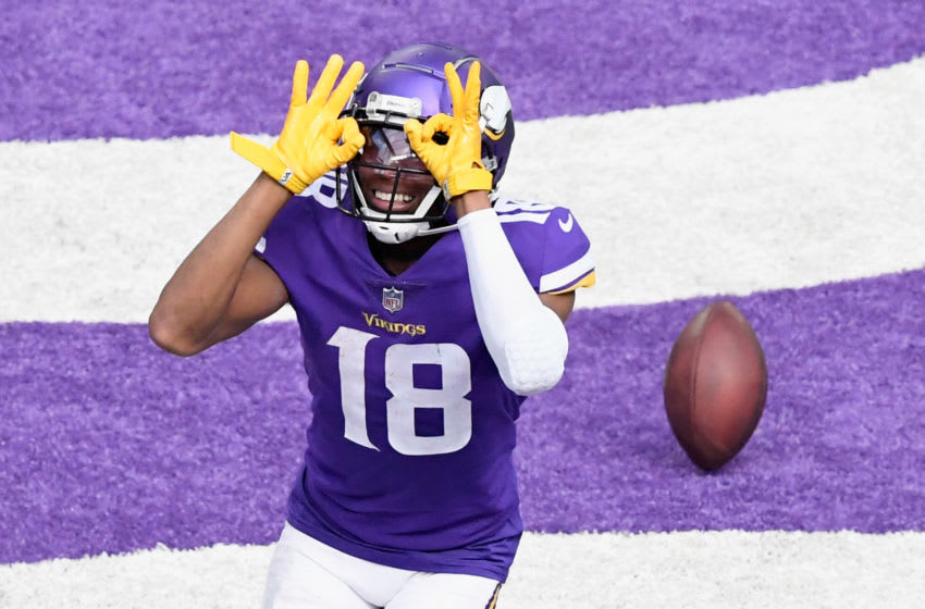 MINNEAPOLIS, MINNESOTA - SEPTEMBER 27: Justin Jefferson #18 of the Minnesota Vikings celebrates a touchdown against the Tennessee Titans during the third quarter of the game at U.S. Bank Stadium on September 27, 2020 in Minneapolis, Minnesota. (Photo by Hannah Foslien/Getty Images)