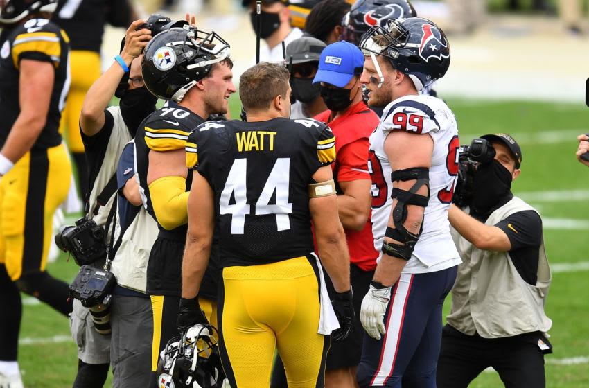 PITTSBURGH, PA - SEPTEMBER 27: T.J. Watt #90, Derek Watt #44 of the Pittsburgh Steelers and J.J. Watt #99 of the Houston Texans talk after Pittsburgh's 28-21 win at Heinz Field on September 27, 2020 in Pittsburgh, Pennsylvania. (Photo by Joe Sargent/Getty Images)