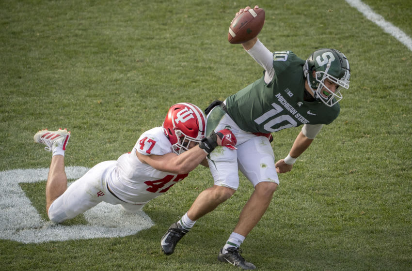 EAST LANSING, MI - NOVEMBER 14: Micah McFadden #47 of the Indiana Hoosiers tackles Payton Thorne #10 of the Michigan State Spartans during the fourth quarter at Spartan Stadium on November 14, 2020 in East Lansing, Michigan. (Photo by Nic Antaya/Getty Images)