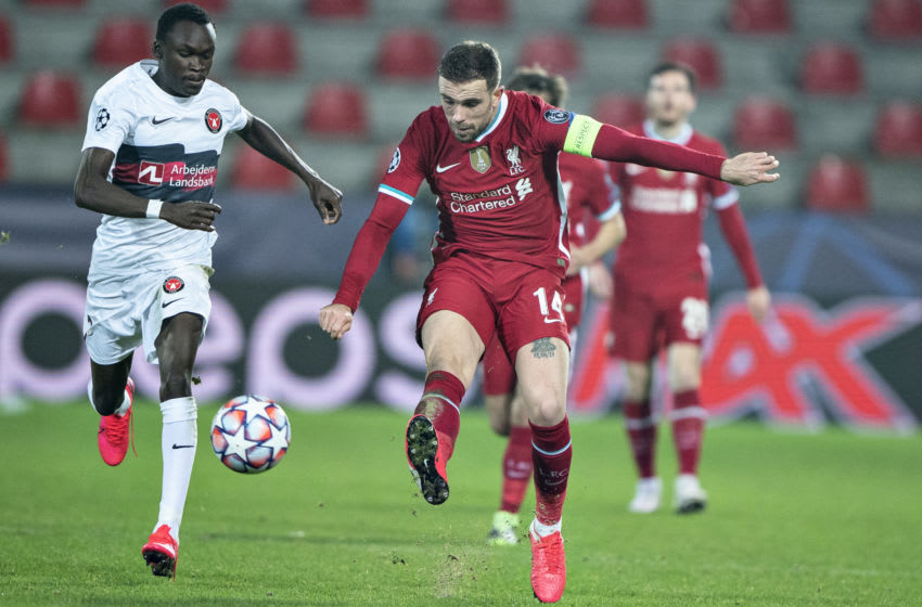 Liverpool's English midfielder Jordan Henderson and Midtjylland's Danish midfielder Pione Sisto vie for the ball during the UEFA Champions League Group D football match FC Midtjylland v Liverpool FC in Herning, Denmark on December 9, 2020. (Photo by Henning Bagger / Ritzau Scanpix / AFP) / Denmark OUT (Photo by HENNING BAGGER/Ritzau Scanpix/AFP via Getty Images)