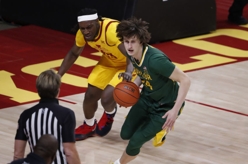 AMES, IA - JANUARY 2: Matthew Mayer #24 of the Baylor Bears steals the ball away from Solomon Young #33 of the Iowa State Cyclones in the second half of play at Hilton Coliseum on January 2, 2021 in Ames, Iowa. The Baylor Bears won 76-65 over the Iowa State Cyclones. (Photo by David Purdy/Getty Images)