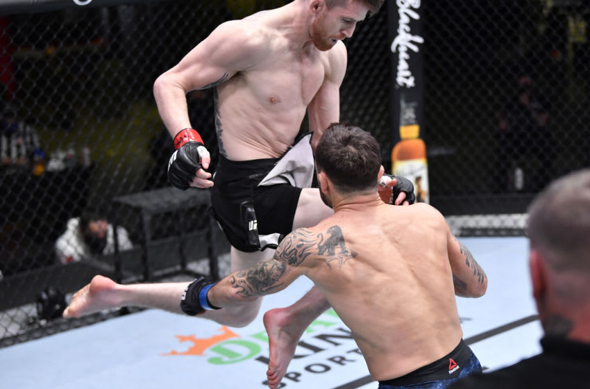 LAS VEGAS, NEVADA - FEBRUARY 06: In this handout image provided by UFC, Cory Sandhagen lands a flying knee to knock out Frankie Edgar in their bantamweight fight during the UFC Fight Night event at UFC APEX on February 06, 2021 in Las Vegas, Nevada. (Photo by Chris Unger/Zuffa LLC via Getty Images)