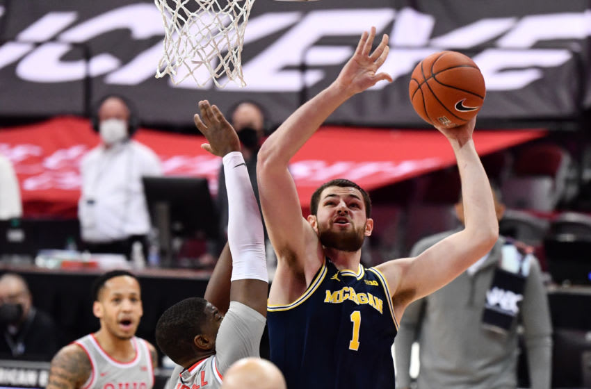 COLUMBUS, OH - FEBRUARY 21: Hunter Dickinson #1 of the Michigan Wolverines drives to the basket in the second half against the Michigan Wolverines at Value City Arena in Columbus, Ohio on February 21, 2021. Michigan defeated Ohio State 92-87. (Photo by Jamie Sabau/Getty Images)