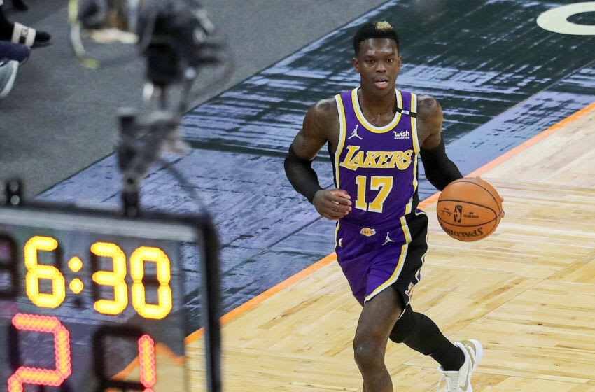 ORLANDO, FL - APRIL 26: Dennis Schroder #17 of the Los Angeles Lakers dribbles the ball up the court against the Orlando Magic during the second half at Amway Center on April 26, 2021 in Orlando, Florida. NOTE TO USER: User expressly acknowledges and agrees that, by downloading and or using this photograph, User is consenting to the terms and conditions of the Getty Images License Agreement. (Photo by Alex Menendez/Getty Images)