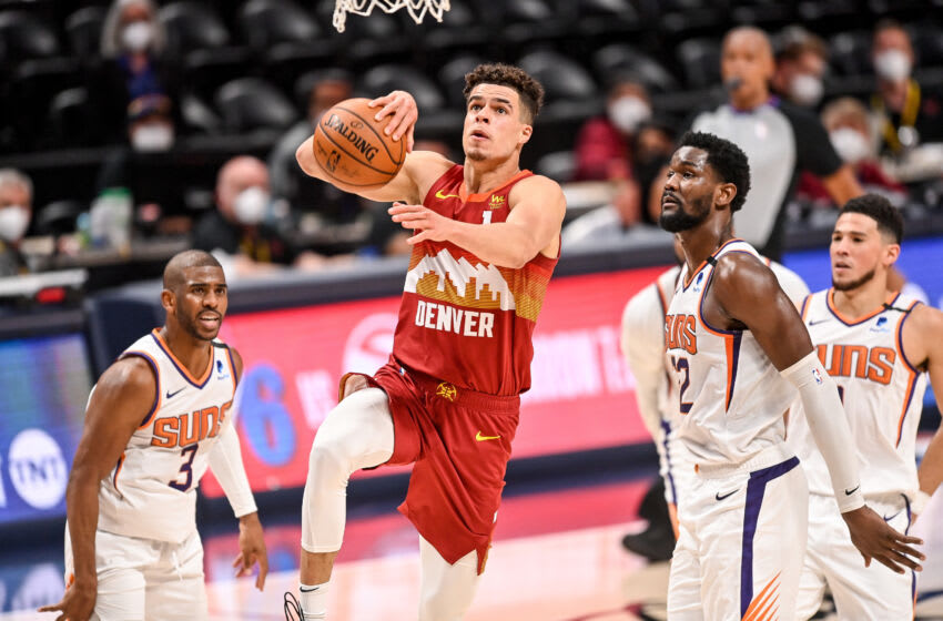 DENVER, CO - JUNE 13: Michael Porter Jr. #1 of the Denver Nuggets drives to the net for slam dunk in Game Four of the Western Conference second-round playoff series at Ball Arena on June 13, 2021 in Denver, Colorado. NOTE TO USER: User expressly acknowledges and agrees that, by downloading and or using this photograph, User is consenting to the terms and conditions of the Getty Images License Agreement. (Photo by Dustin Bradford/Getty Images)