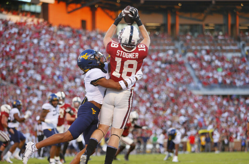 NORMAN, OK - SEPTEMBER 25: Tight end Austin Stogner #18 of the Oklahoma Sooners grabs a catch for a touchdown against cornerback Daryl Porter Jr. #2 of the West Virginia Mountaineers in the first quarter at Gaylord Family Oklahoma Memorial Stadium on September 25, 2021 in Norman, Oklahoma. (Photo by Brian Bahr/Getty Images)