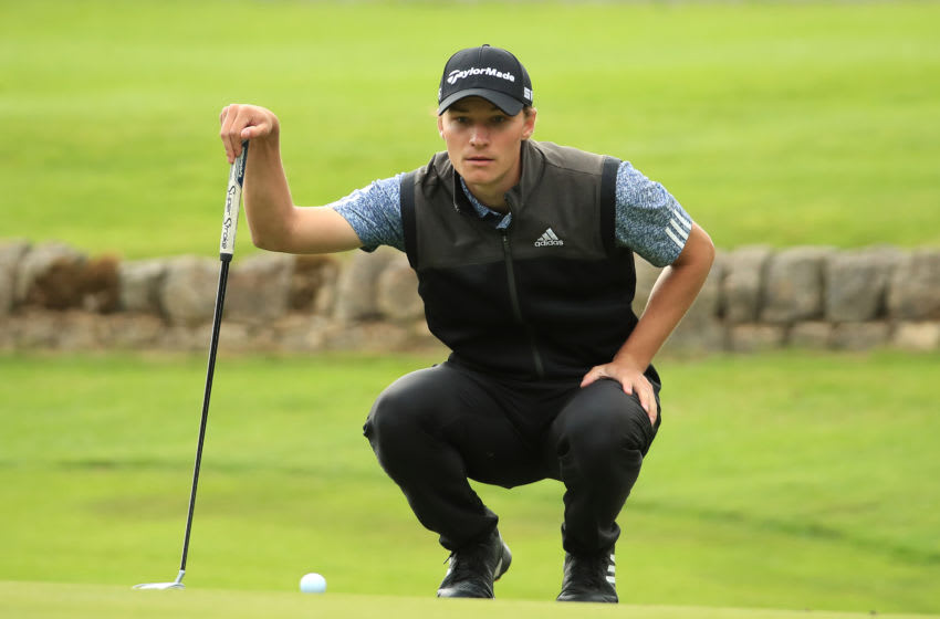 NEWCASTLE UPON TYNE, ENGLAND - JULY 25: Rasmus Hojgaard of Denmark lines up a birdie putt on the 18th green during final round of the Betfred British Masters at Close House Golf Club on July 25, 2020 in Newcastle upon Tyne, England. (Photo by Andrew Redington/Getty Images)