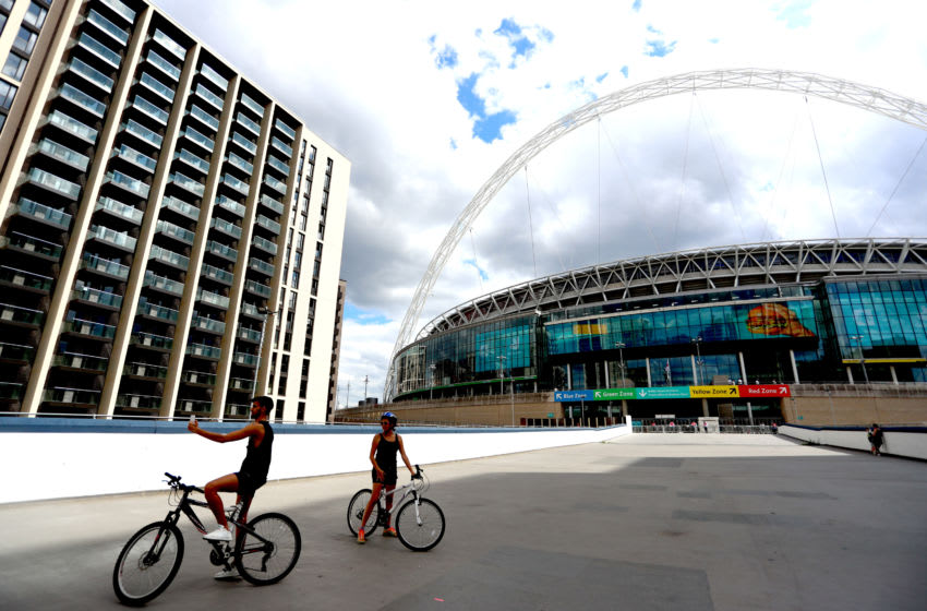 LONDON, ENGLAND - AUGUST 01: 2 Cyclists stand outside of the stadium ahead of the FA Cup Final match between Arsenal and Chelsea at Wembley Stadium on August 01, 2020 in London, England. Football Stadiums around Europe remain empty due to the Coronavirus Pandemic as Government social distancing laws prohibit fans inside venues resulting in all fixtures being played behind closed doors. (Photo by Chloe Knott - Danehouse/Getty Images)