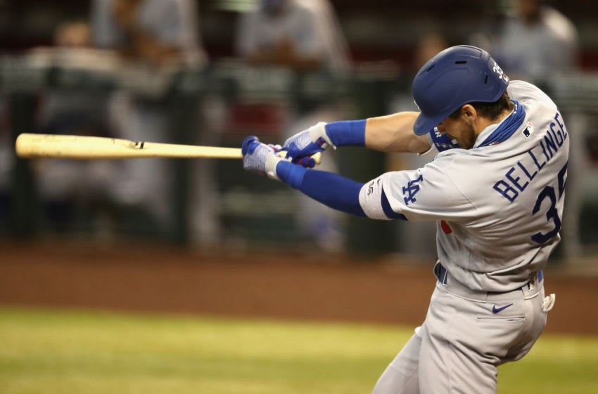 PHOENIX, ARIZONA - AUGUST 02: Cody Bellinger #35 of the Los Angeles Dodgers hits a two-run home run against the Arizona Diamondbacks during the first inning of the MLB game at Chase Field on August 02, 2020 in Phoenix, Arizona. (Photo by Christian Petersen/Getty Images)