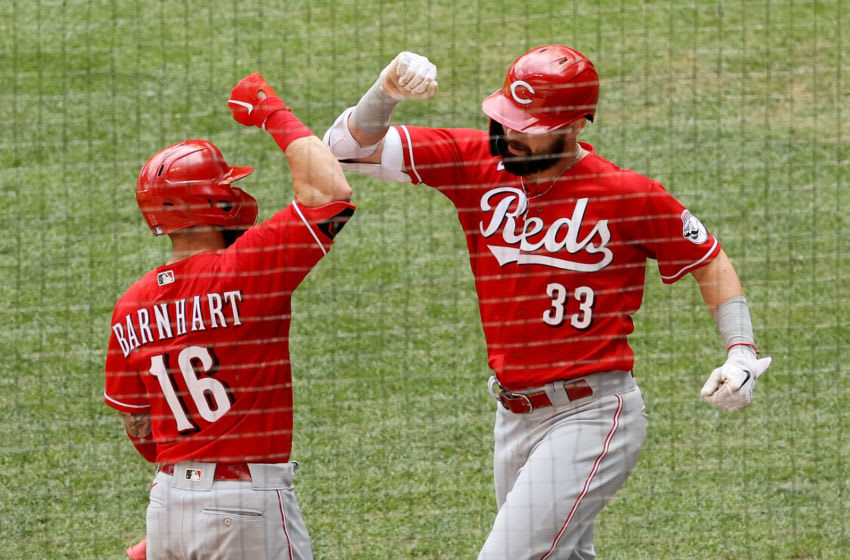 MILWAUKEE, WISCONSIN - AUGUST 09: Tucker Barnhart #16 and Jesse Winker #33 of the Cincinnati Reds (Photo by Dylan Buell/Getty Images)