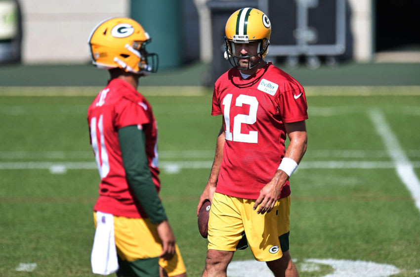 ASHWAUBENON, WISCONSIN - AUGUST 17: Aaron Rodgers #12 of the Green Bay Packers and Jordan Love #10 participate in work outs during training camp at Ray Nitschke Field on August 17, 2020 in Ashwaubenon, Wisconsin. (Photo by Stacy Revere/Getty Images)