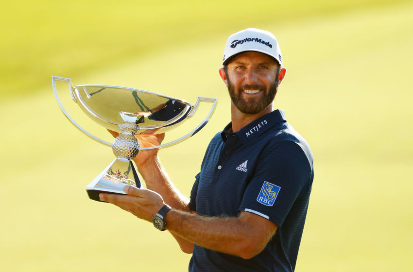 ATLANTA, GEORGIA - SEPTEMBER 07: Dustin Johnson of the United States celebrates with the FedEx Cup Trophy after winning in the final round of the TOUR Championship at East Lake Golf Club on September 07, 2020 in Atlanta, Georgia. (Photo by Kevin C. Cox/Getty Images)