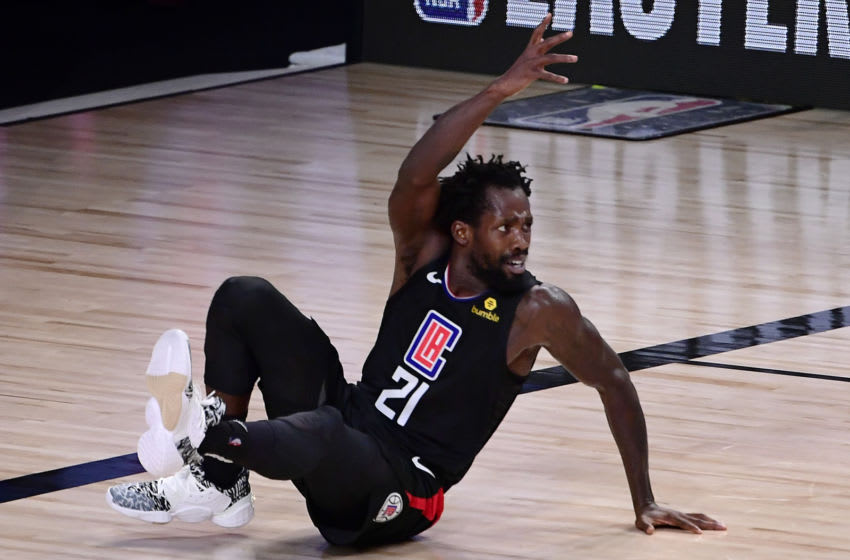 LAKE BUENA VISTA, FLORIDA - SEPTEMBER 15: Patrick Beverley #21 of the LA Clippers reacts during the second quarter against the Denver Nuggets in Game Seven of the Western Conference Second Round during the 2020 NBA Playoffs at AdventHealth Arena at the ESPN Wide World Of Sports Complex on September 15, 2020 in Lake Buena Vista, Florida. NOTE TO USER: User expressly acknowledges and agrees that, by downloading and or using this photograph, User is consenting to the terms and conditions of the Getty Images License Agreement. (Photo by Douglas P. DeFelice/Getty Images)