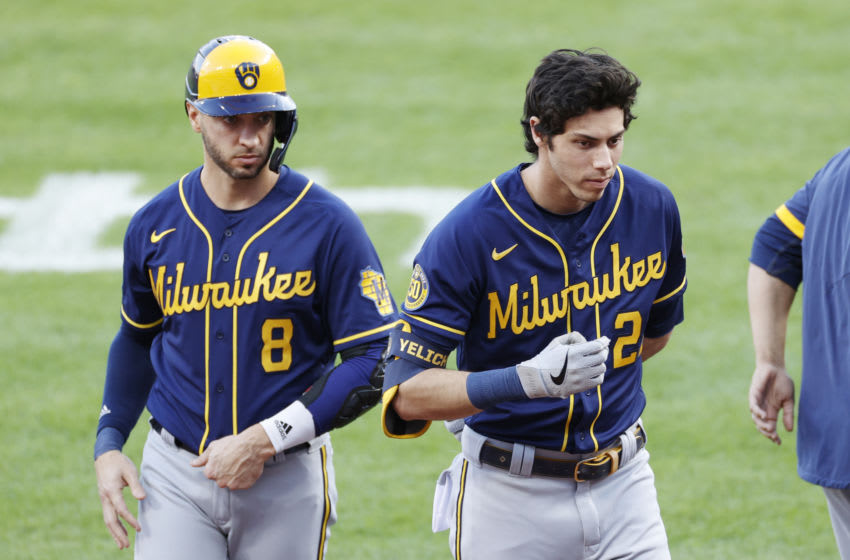 CINCINNATI, OH - SEPTEMBER 21: Christian Yelich #22 and Ryan Braun #8 of the Milwaukee Brewers look on during a game against the Cincinnati Reds at Great American Ball Park on September 21, 2020 in Cincinnati, Ohio. The Reds won 6-3. (Photo by Joe Robbins/Getty Images)