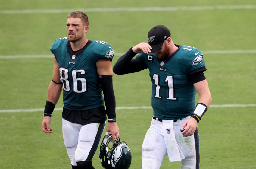 PHILADELPHIA, PENNSYLVANIA - SEPTEMBER 27: Zach Ertz #86 and quarterback Carson Wentz #11 of the Philadelphia Eagles walk off the field after a 23-23 tie against the Cincinnati Bengals at Lincoln Financial Field on September 27, 2020 in Philadelphia, Pennsylvania. (Photo by Rob Carr/Getty Images)