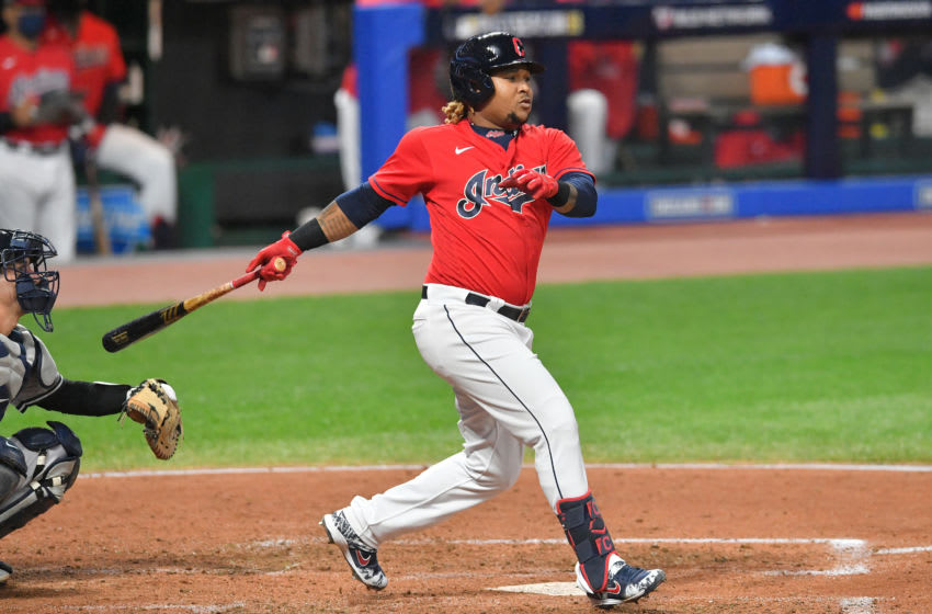 CLEVELAND, OHIO - SEPTEMBER 29: Jose Ramirez #11 of the Cleveland Indians hits an RBI double during the third inning of Game One of the American League Wild Card Series against the New York Yankees at Progressive Field on September 29, 2020 in Cleveland, Ohio. (Photo by Jason Miller/Getty Images)