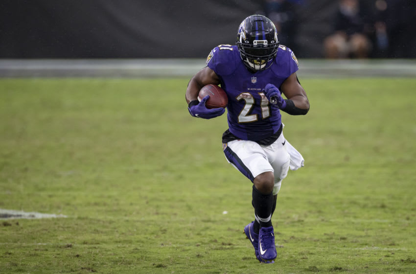 BALTIMORE, MD - OCTOBER 11: Mark Ingram #21 of the Baltimore Ravens carries the ball against the Cincinnati Bengals during the second half at M&T Bank Stadium on October 11, 2020 in Baltimore, Maryland. (Photo by Scott Taetsch/Getty Images)