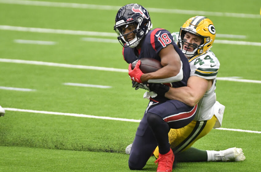 HOUSTON, TEXAS - OCTOBER 25: Randall Cobb #18 of the Houston Texans is tackled by Ty Summers #44 of the Green Bay Packers after a reception during the third quarter at NRG Stadium on October 25, 2020 in Houston, Texas. (Photo by Logan Riely/Getty Images)
