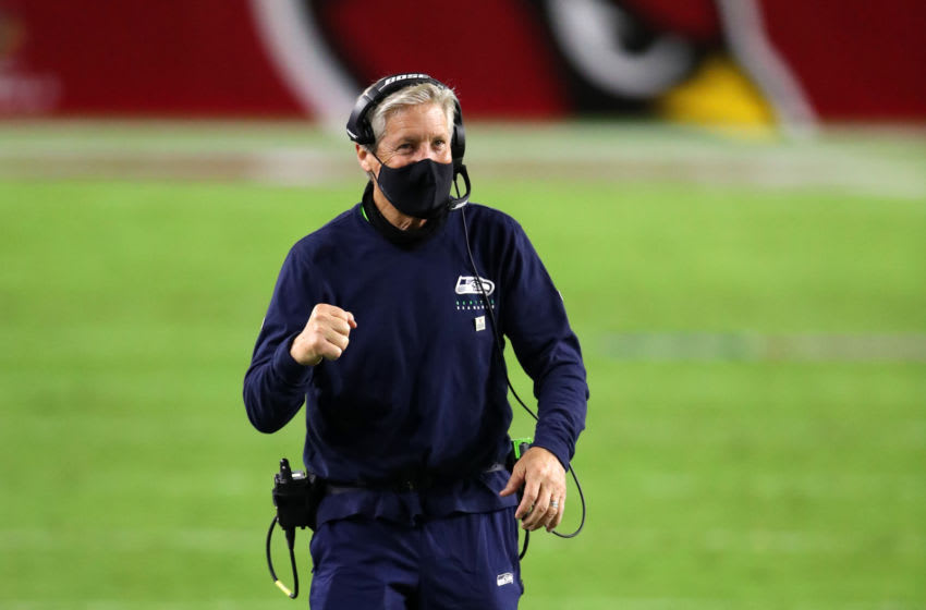 GLENDALE, ARIZONA - OCTOBER 25: Head coach Pete Carroll of the Seattle Seahawks reacts with a fist pump after an initial ruling of no touchdown on an end zone reception by wide receiver Tyler Lockett #16 of the Seattle Seahawks was reversed to that of a touchdown in the fourth quarter of the game against the Arizona Cardinals at State Farm Stadium on October 25, 2020 in Glendale, Arizona. (Photo by Christian Petersen/Getty Images)