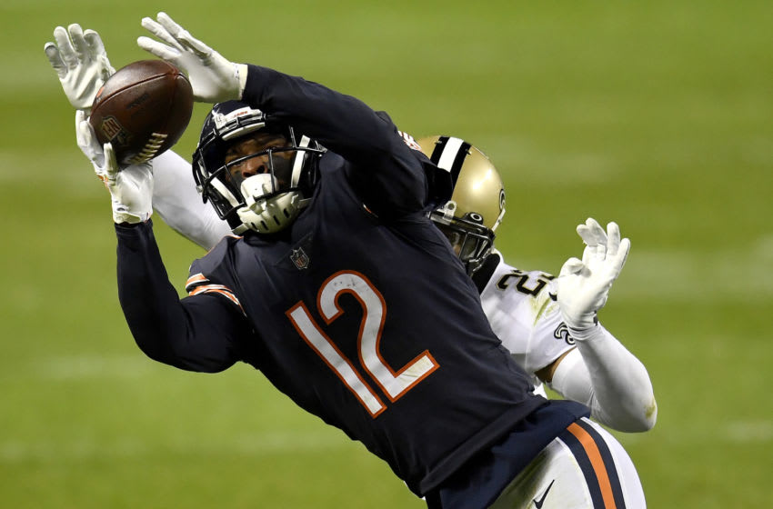 CHICAGO, ILLINOIS - NOVEMBER 01: Allen Robinson II #12 of the Chicago Bears makes a pass reception against Marshon Lattimore #23 of the New Orleans Saints in overtime at Soldier Field on November 01, 2020 in Chicago, Illinois. (Photo by Quinn Harris/Getty Images)