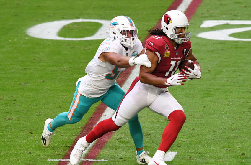 GLENDALE, ARIZONA - NOVEMBER 08: Larry Fitzgerald #11 of the Arizona Cardinals carries the ball as Kamu Grugier-Hill #51 of the Miami Dolphins defends during the first half at State Farm Stadium on November 08, 2020 in Glendale, Arizona. (Photo by Norm Hall/Getty Images)