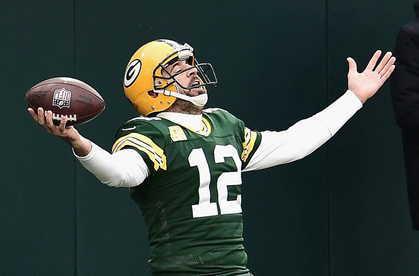 GREEN BAY, WISCONSIN - NOVEMBER 15: Aaron Rodgers #12 of the Green Bay Packers celebrates scoring his first running touchdown of the season in the 2nd quarter against the Jacksonville Jaguars at Lambeau Field on November 15, 2020 in Green Bay, Wisconsin. (Photo by Stacy Revere/Getty Images)