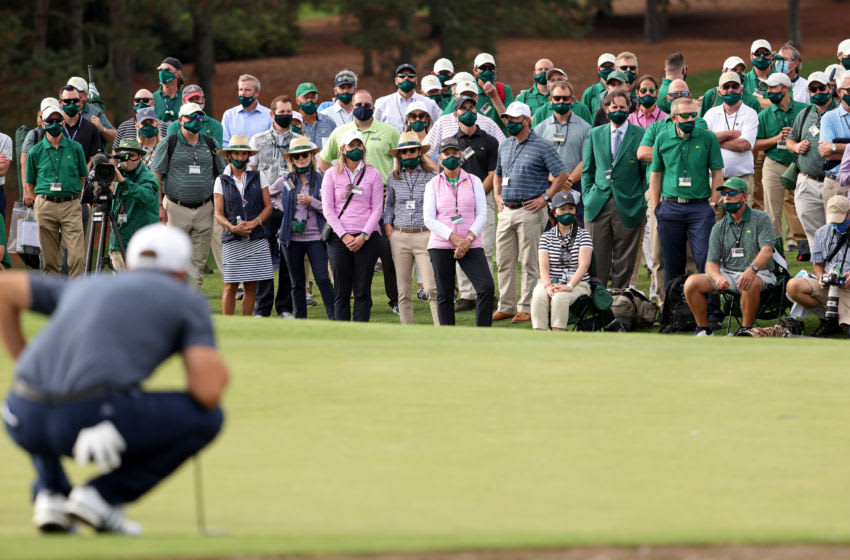 AUGUSTA, GEORGIA - NOVEMBER 15: A view of the gallery as Dustin Johnson of the United States lines up a putt on the 18th green during the final round of the Masters at Augusta National Golf Club on November 15, 2020 in Augusta, Georgia. (Photo by Jamie Squire/Getty Images)