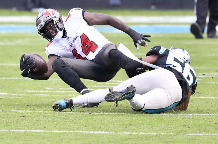 CHARLOTTE, NORTH CAROLINA - NOVEMBER 15: Chris Godwin #14 of the Tampa Bay Buccaneers is tackled by Jermaine Carter #56 of the Carolina Panthers during their NFL game at Bank of America Stadium on November 15, 2020 in Charlotte, North Carolina. (Photo by Grant Halverson/Getty Images)
