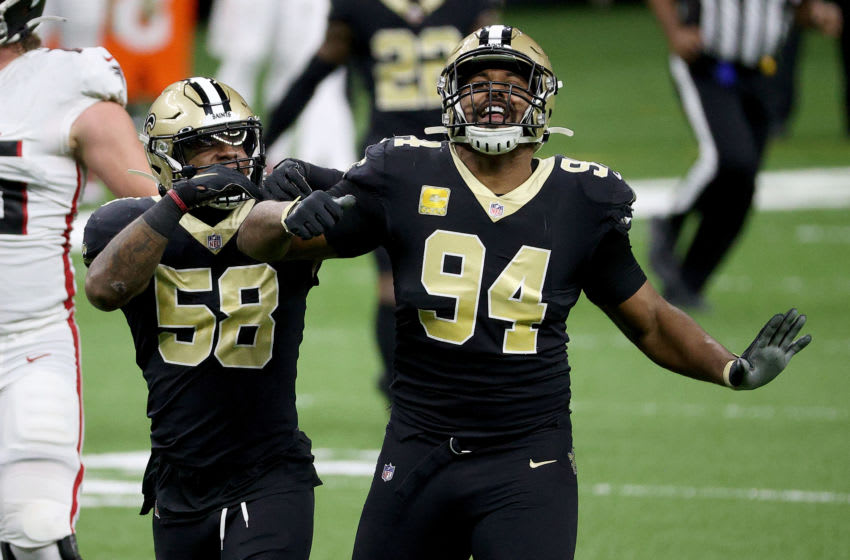 NEW ORLEANS, LOUISIANA - NOVEMBER 22: Cameron Jordan #94 of the New Orleans Saints celebrates with teammate Kwon Alexander #58 after Jordan sacked quarterback Matt Ryan of the Atlanta Falcons in the first quarter at Mercedes-Benz Superdome on November 22, 2020 in New Orleans, Louisiana. (Photo by Chris Graythen/Getty Images)