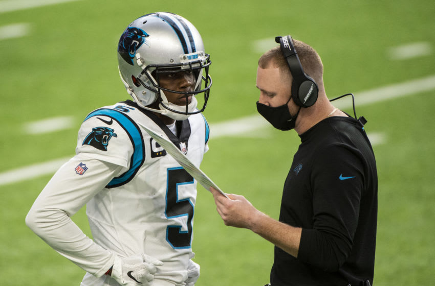 MINNEAPOLIS, MN - NOVEMBER 29: Teddy Bridgewater #5 of the Carolina Panthers speaks with offensive coordinator Joe Brady in the fourth quarter of the game against the Minnesota Vikings at U.S. Bank Stadium on November 29, 2020 in Minneapolis, Minnesota. (Photo by Stephen Maturen/Getty Images)