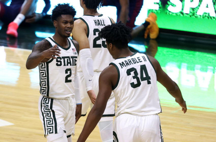 EAST LANSING, MICHIGAN - DECEMBER 04: Rocket Watts #2 of the Michigan State Spartans celebrates a first half play with Julius Marble II #34 while playing the Detroit Titans at Breslin Center on December 04, 2020 in East Lansing, Michigan. (Photo by Gregory Shamus/Getty Images)