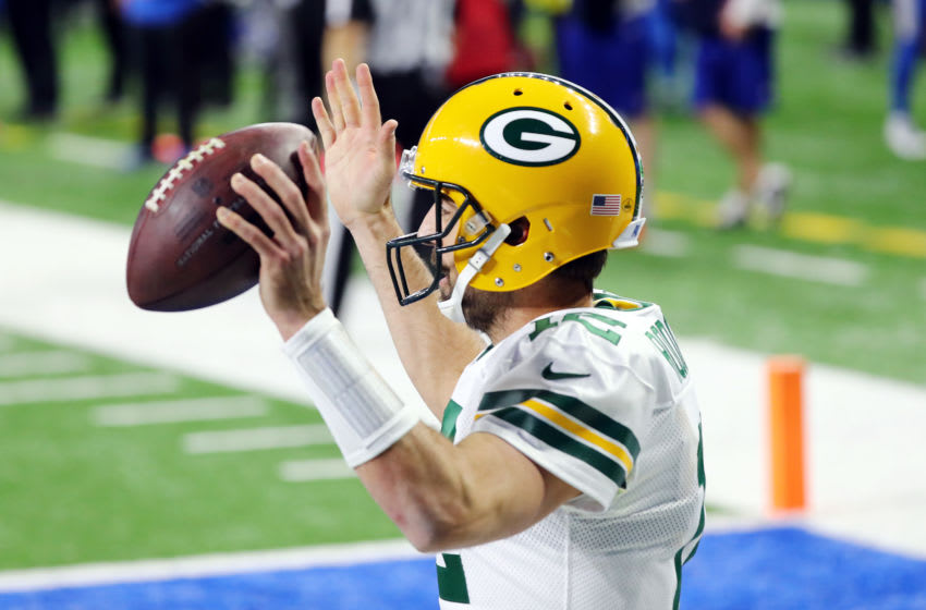 DETROIT, MICHIGAN - DECEMBER 13: Aaron Rodgers #12 of the Green Bay Packers celebrates rushing for a touchdown during the third quarter against the Detroit Lions at Ford Field on December 13, 2020 in Detroit, Michigan. (Photo by Rey Del Rio/Getty Images)
