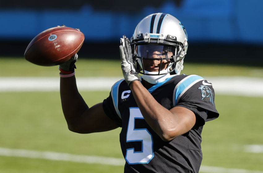CHARLOTTE, NORTH CAROLINA - DECEMBER 13: Teddy Bridgewater #5 of the Carolina Panthers tosses to stay loose during the first quarter of their game against the Denver Broncos at Bank of America Stadium on December 13, 2020 in Charlotte, North Carolina. (Photo by Jared C. Tilton/Getty Images)