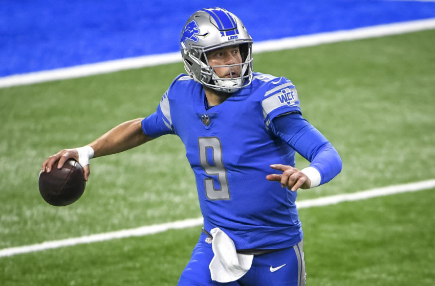DETROIT, MICHIGAN - DECEMBER 13: Matthew Stafford #9 of the Detroit Lions looks to pass against the Green Bay Packers during the first half at Ford Field on December 13, 2020 in Detroit, Michigan. (Photo by Nic Antaya/Getty Images)