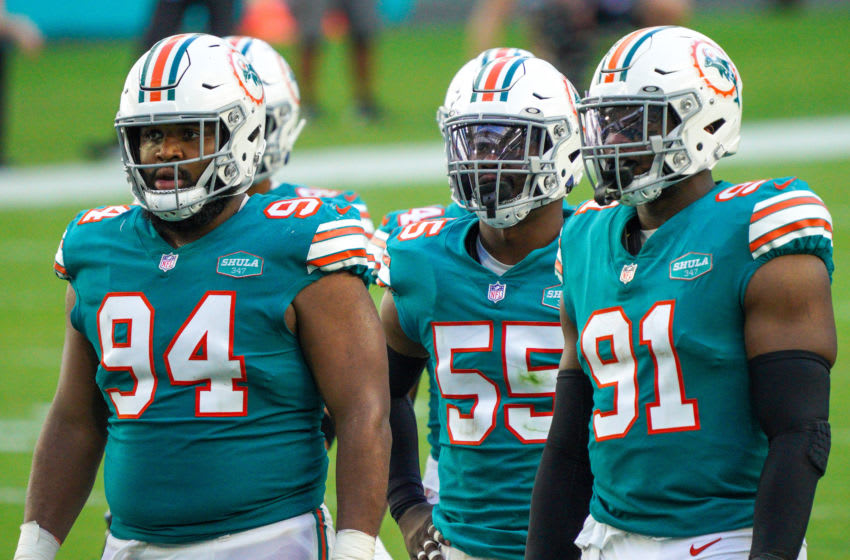 MIAMI GARDENS, FLORIDA - DECEMBER 13: (L-R) Christian Wilkins #94, Jerome Baker #55, Emmanuel Ogbah #91 of the Miami Dolphins line up against the Kansas City Chiefs at Hard Rock Stadium on December 13, 2020 in Miami Gardens, Florida. (Photo by Mark Brown/Getty Images)
