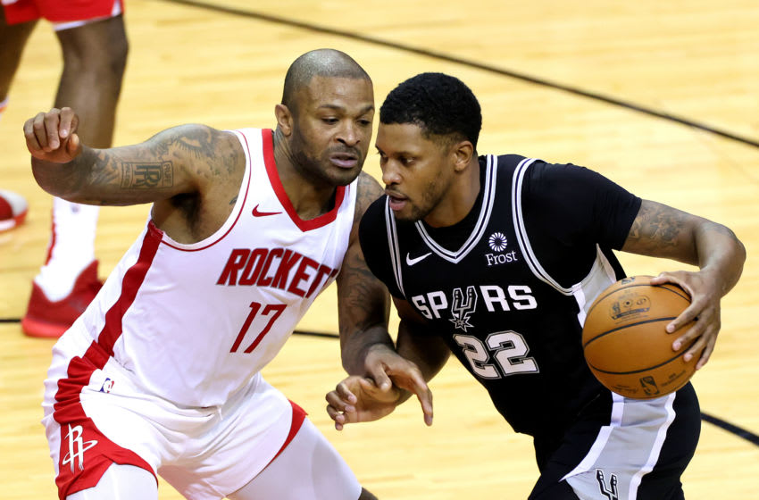 HOUSTON, TEXAS - DECEMBER 17: Rudy Gay #22 of the San Antonio Spurs drives against P.J. Tucker #17 of the Houston Rockets during the third quarter at the Toyota Center on December 17, 2020 in Houston, Texas. NOTE TO USER: User expressly acknowledges and agrees that, by downloading and or using this photograph, User is consenting to the terms and conditions of the Getty Images License Agreement. (Photo by Carmen Mandato/Getty Images)
