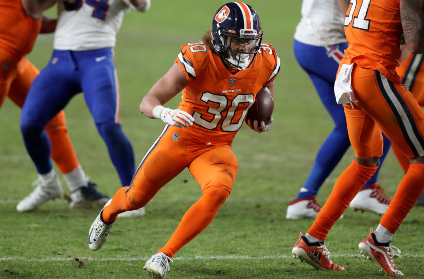 DENVER, COLORADO - DECEMBER 19: Phillip Lindsay #30 of the Denver Broncos rushes the ball during the fourth quarter against the Buffalo Bills at Empower Field At Mile High on December 19, 2020 in Denver, Colorado. (Photo by Matthew Stockman/Getty Images)