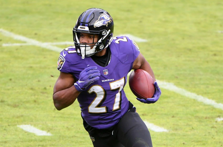 BALTIMORE, MARYLAND - DECEMBER 20: Running back JK Dobbins # 27 of the Baltimore Ravens runs against the Jacksonville Jaguars in the first half at M&T Bank Stadium on December 20, 2020 in Baltimore, Maryland.  (Photo by Will Newton / Getty Images)