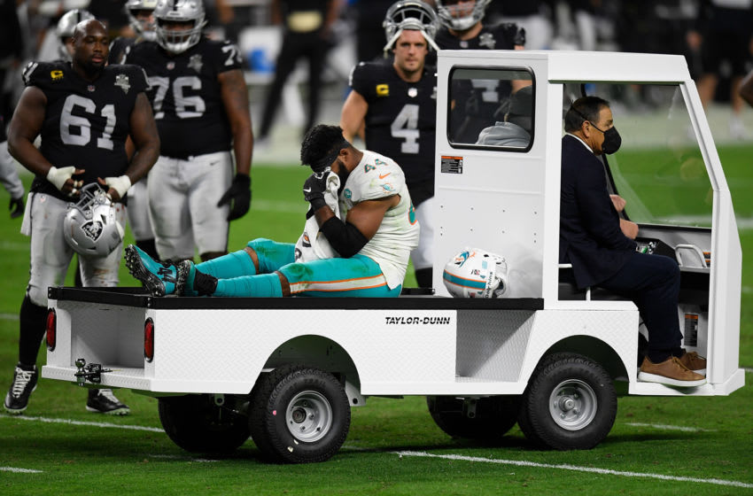 LAS VEGAS, NEVADA - DECEMBER 26: Elandon Roberts #44 of the Miami Dolphins leaves the field with an injury during the third quarter of a game against the Las Vegas Raiders at Allegiant Stadium on December 26, 2020 in Las Vegas, Nevada. (Photo by Harry How/Getty Images)